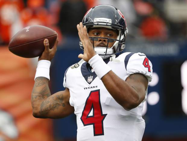 Houston Texans quarterback Deshaun Watson (4) warms up prior to an NFL football game against the Denver Broncos, Sunday, Nov. 4, 2018, in Denver. (AP Photo/Jack Dempsey)