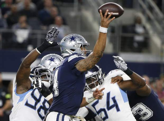 Dallas Cowboys quarterback Dak Prescott (4) works under pressure in the pocket against the Tennessee Titans during the first half of an NFL football game, Monday, Nov. 5, 2018, in Arlington, Texas. (AP Photo/Michael Ainsworth)