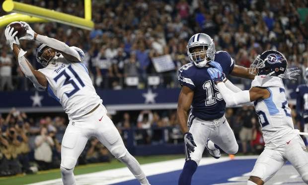 Tennessee Titans free safety Kevin Byard (31) intercepts a pass intended for Dallas Cowboys wide receiver Amari Cooper (19) during the first half of an NFL football game, Monday, Nov. 5, 2018, in Arlington, Texas. (AP Photo/Michael Ainsworth)