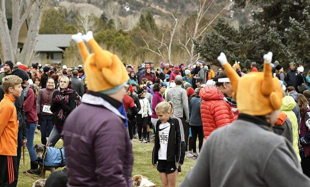 A throng of people gather near the clubhouse for the 32nd annual Turkey 5K Thursday at the Glenwood Springs Golf Course.