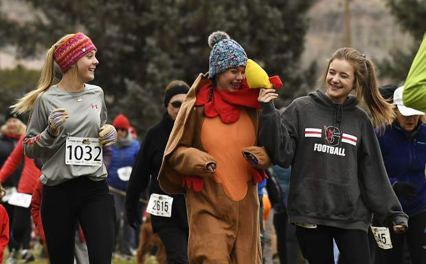 A trio of runners have fun as they start the 32nd annual Turkey Day 5K Thursday at the Glenwood Springs Golf Course.