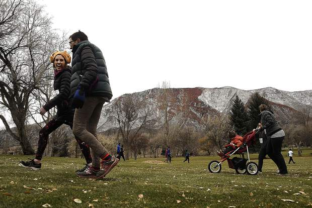 Participants enjoy the 32nd annual Turkey Day 5K Thursday at the Glenwood Springs Golf Course.