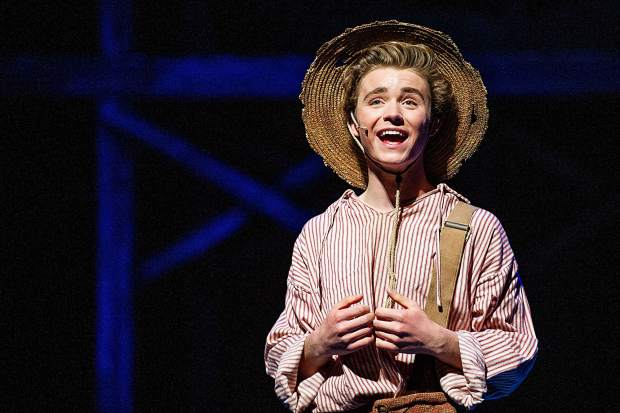 Patrick Keleher playing Huck Finn in a scene from the Aspen Community Theatre dress rehearsal of the musical