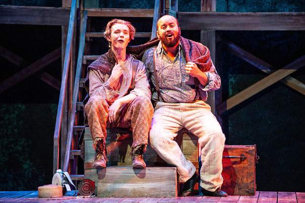 Gerald DeLisser, right, playing Jim and Patrick Keleher playing Huck Finn in a scene from the Aspen Community Theatre dress rehearsal of the musical