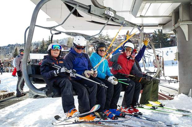 Skiers board the Village Express Lift at Snowmass Mountain for opening day on Thursday.