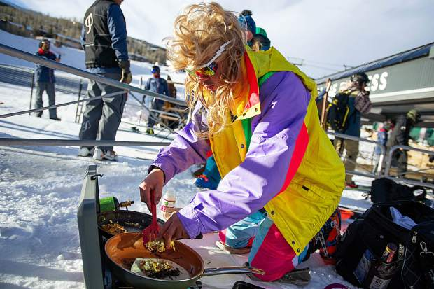 Liam Sipsey grills up some breakfast burritos at the base of Snowmass Mountain in memory of the tradition with Angus Graham who died summer of August 2017.