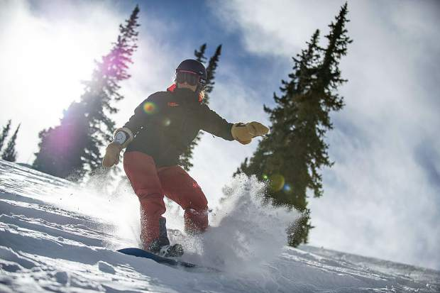 Tiffany Cook rides through some powder on Snowmass Mountain for opening day Thursday.