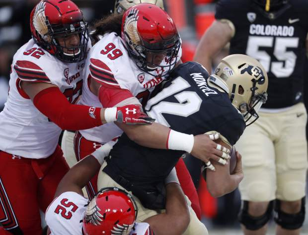 Colorado quarterback Steven Montez (12) is sacked by Utah defensive tackle John Penisini (99), and defensive end Maxs Tupai (92) and defensive tackle Leki Fotu (52) in the second half of an NCAA college football game Saturday, Nov. 17, 2018, in Boulder, Colo. Montez injured his leg on the play. Utah won 30-7. (AP Photo/David Zalubowski)