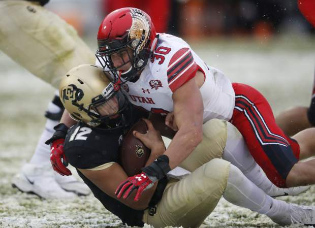 Utah linebacker Cody Barton, top, tackles Colorado quarterback Steven Montez after a short run in the second half of an NCAA college football game Saturday, Nov. 17, 2018, in Boulder, Colo. Utah won 30-7. (AP Photo/David Zalubowski)