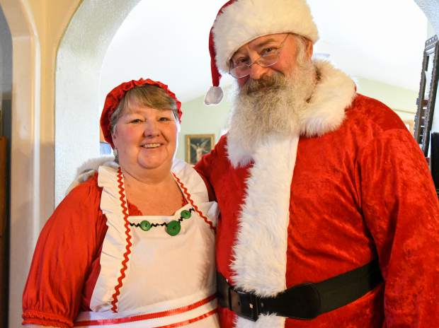 Kim and Waynetta Antonelli in their handmade Santa and Mrs.Claus suits at their home in Silt.