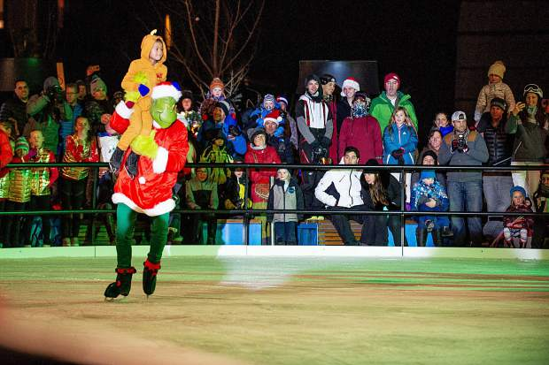 The Grinch or Kelly Smith performing as The Grinch Saturday night in the Snowmass Base Village plaza.