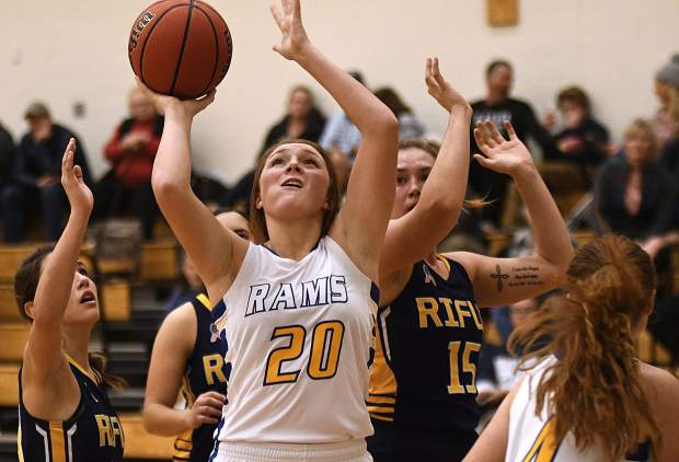Roaring Fork's Caroline Wisroth put up a shot surrounded by Rifle Bears during fourth quarter action Saturday in Carbondale. The Rams beat the Bears 42-32 during second day action of the Brenda Patch Tournament in Carbondale.