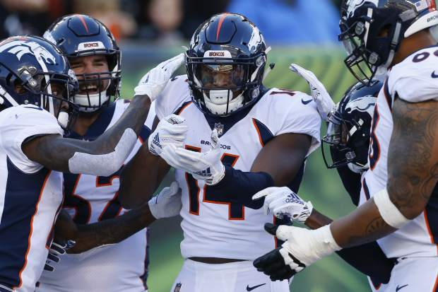 Denver Broncos wide receiver Courtland Sutton (14) celebrates his touchdown with his teammates in the first second of an NFL football game, Sunday, Dec. 2, 2018, in Cincinnati. (AP Photo/Gary Landers)