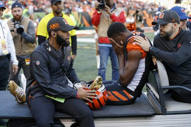 Cincinnati Bengals wide receiver A.J. Green, center, is carted off the field after sustaining an injury in the first half of an NFL football game against the Denver Broncos, Sunday, Dec. 2, 2018, in Cincinnati. (AP Photo/Frank Victores)