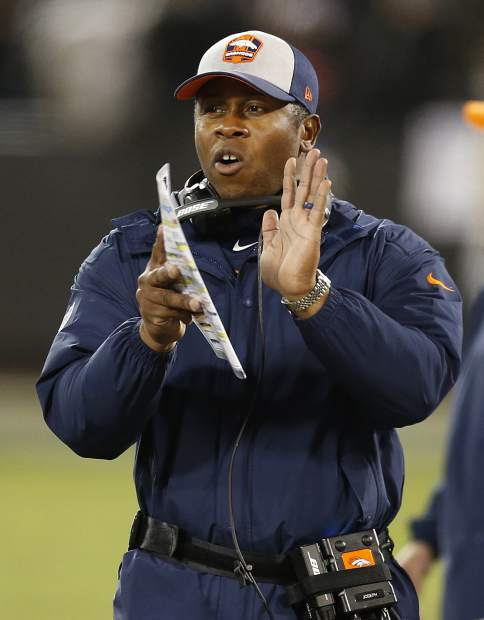 Denver Broncos head coach Vance Joseph gestures during the second half of an NFL football game against the Oakland Raiders in Oakland, Calif., Monday, Dec. 24, 2018. (AP Photo/D. Ross Cameron)