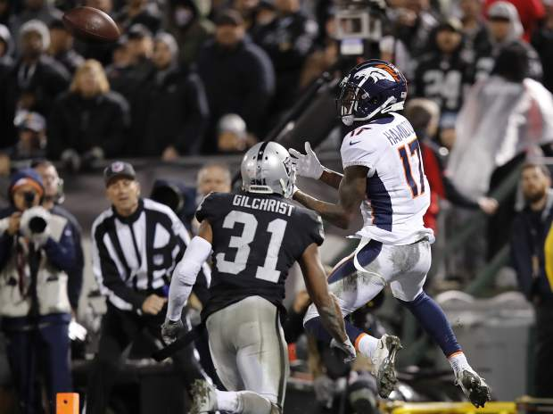 Denver Broncos wide receiver DaeSean Hamilton (17) catches a touchdown pass against Oakland Raiders defensive back Marcus Gilchrist (31) during the second half of an NFL football game in Oakland, Calif., Monday, Dec. 24, 2018. (AP Photo/John Hefti)