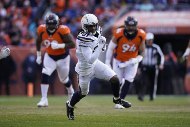 Los Angeles Chargers wide receiver Mike Williams (81) runs with the ball during the first half of an NFL football game against the Denver Broncos, Sunday, Dec. 30, 2018, in Denver. (AP Photo/Jack Dempsey)