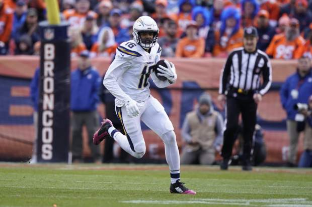 Los Angeles Chargers wide receiver Tyrell Williams runs with the ball during the first half of an NFL football game against the Denver Broncos, Sunday, Dec. 30, 2018, in Denver. (AP Photo/Jack Dempsey)