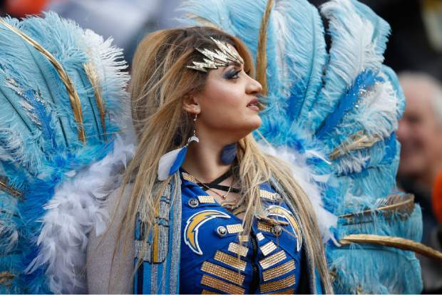 A Los Angeles Chargers fan looks on during the first half of an NFL football game against the Denver Broncos, Sunday, Dec. 30, 2018, in Denver. (AP Photo/David Zalubowski)