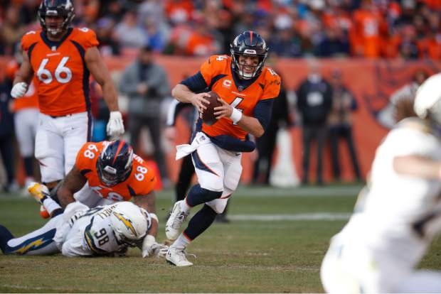 Denver Broncos quarterback Case Keenum runs with the ball during the first half of an NFL football game against the Los Angeles Chargers, Sunday, Dec. 30, 2018, in Denver. (AP Photo/David Zalubowski)