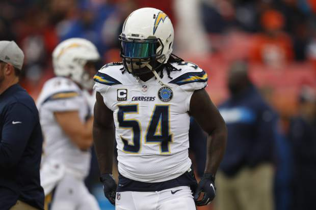 Los Angeles Chargers defensive end Melvin Ingram warms up before an NFL football game between the Los Angeles Chargers and the Denver Broncos, Sunday, Dec. 30, 2018, in Denver. (AP Photo/David Zalubowski)
