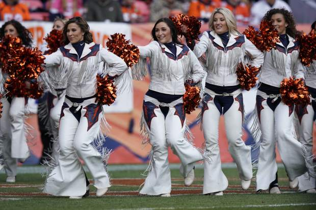Denver Broncos cheerleaders perform during the first half of an NFL football game against the Los Angeles Chargers, Sunday, Dec. 30, 2018, in Denver. (AP Photo/Jack Dempsey)