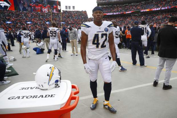 Los Angeles Chargers linebacker Uchenna Nwosu looks on before an NFL football game against the Denver Broncos, Sunday, Dec. 30, 2018, in Denver. (AP Photo/David Zalubowski)