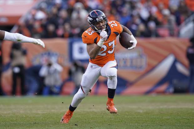 Denver Broncos running back Devontae Booker (23) rushes during the first half of an NFL football game against the Los Angeles Chargers, Sunday, Dec. 30, 2018, in Denver. (AP Photo/Jack Dempsey)