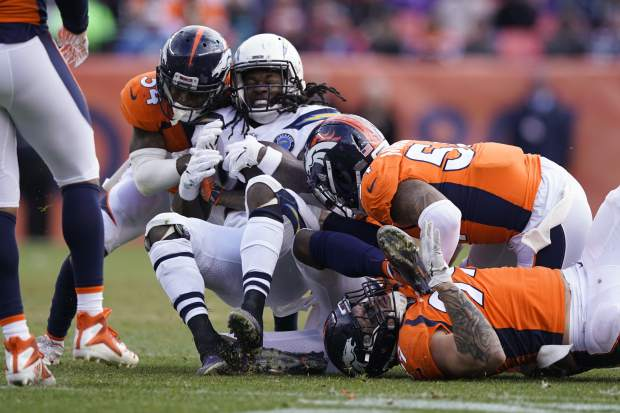 Los Angeles Chargers running back Melvin Gordon rushes during the first half of an NFL football game against the Denver Broncos, Sunday, Dec. 30, 2018, in Denver. (AP Photo/Jack Dempsey)