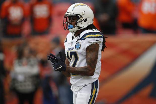 Los Angeles Chargers wide receiver Travis Benjamin warms up before an NFL football game between the Los Angeles Chargers and the Denver Broncos, Sunday, Dec. 30, 2018, in Denver. (AP Photo/David Zalubowski)