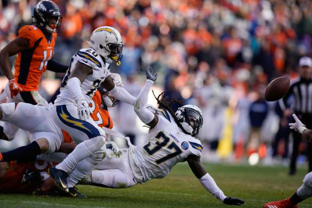 Los Angeles Chargers strong safety Jahleel Addae (37) chases a fumble after making an interception during the first half of an NFL football game against the Denver Broncos, Sunday, Dec. 30, 2018, in Denver. (AP Photo/Jack Dempsey)