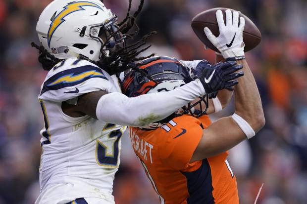 Denver Broncos wide receiver River Cracraft, right, makes a catch as Los Angeles Chargers strong safety Jahleel Addae, left, defends during the first half of an NFL football game, Sunday, Dec. 30, 2018, in Denver. (AP Photo/Jack Dempsey)