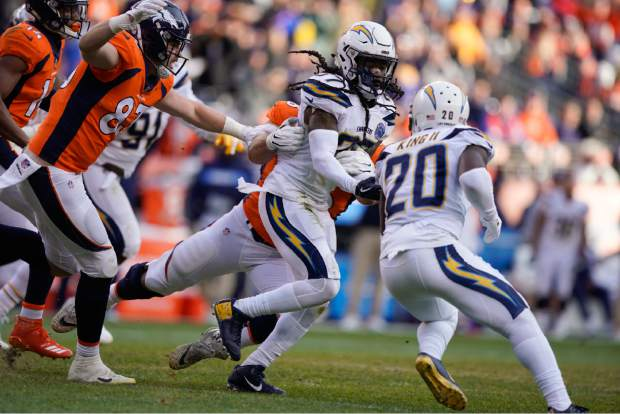 Los Angeles Chargers strong safety Jahleel Addae (37) runs with the ball after making an interception during the first half of an NFL football game against the Denver Broncos, Sunday, Dec. 30, 2018, in Denver. (AP Photo/Jack Dempsey)