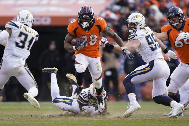 Denver Broncos running back Royce Freeman rushes during the first half of an NFL football game against the Los Angeles Chargers, Sunday, Dec. 30, 2018, in Denver. (AP Photo/Jack Dempsey)