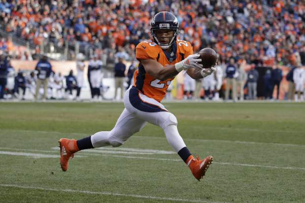 Denver Broncos running back Devontae Booker hauls in a pass during the first half of an NFL football game against the Los Angeles Chargers, Sunday, Dec. 30, 2018, in Denver. (AP Photo/Jack Dempsey)
