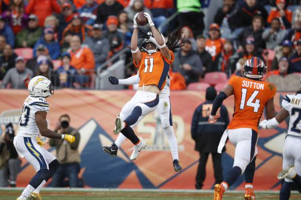 Denver Broncos wide receiver River Cracraft hauls in a pass as Los Angeles Chargers strong safety Jahleel Addae defends during the first half of an NFL football game, Sunday, Dec. 30, 2018, in Denver. (AP Photo/David Zalubowski)
