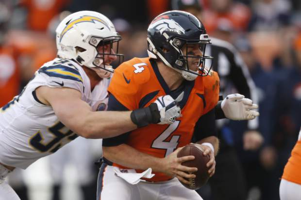 Los Angeles Chargers defensive end Joey Bosa, left, sacks Denver Broncos quarterback Case Keenum during the first half of an NFL football game, Sunday, Dec. 30, 2018, in Denver. (AP Photo/David Zalubowski)