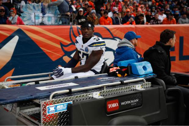 Los Angeles Chargers outside linebacker Jatavis Brown leaves the field on a cart after an injury during the first half of an NFL football game against the Denver Broncos, Sunday, Dec. 30, 2018, in Denver. (AP Photo/David Zalubowski)