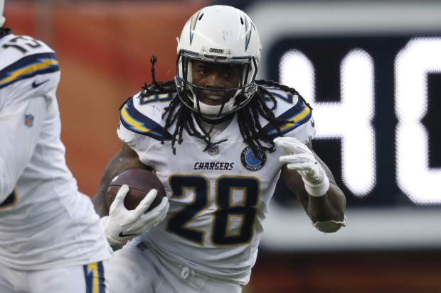 Los Angeles Chargers running back Melvin Gordon rushes during the second half of an NFL football game against the Denver Broncos, Sunday, Dec. 30, 2018, in Denver. (AP Photo/David Zalubowski)