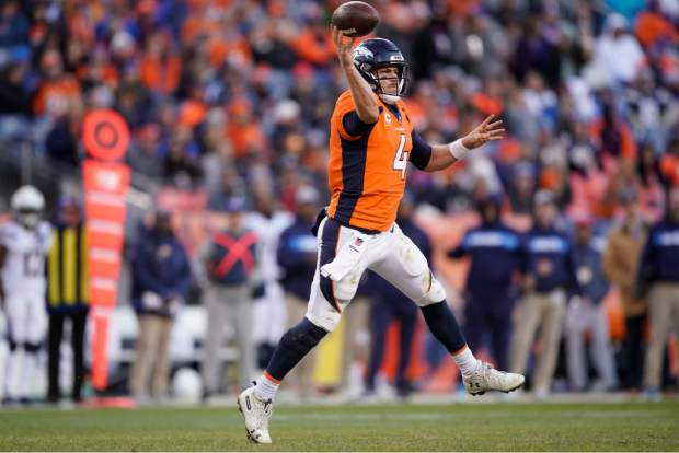 Denver Broncos quarterback Case Keenum throws a pass during the second half of an NFL football game against the Los Angeles Chargers, Sunday, Dec. 30, 2018, in Denver. (AP Photo/Jack Dempsey)