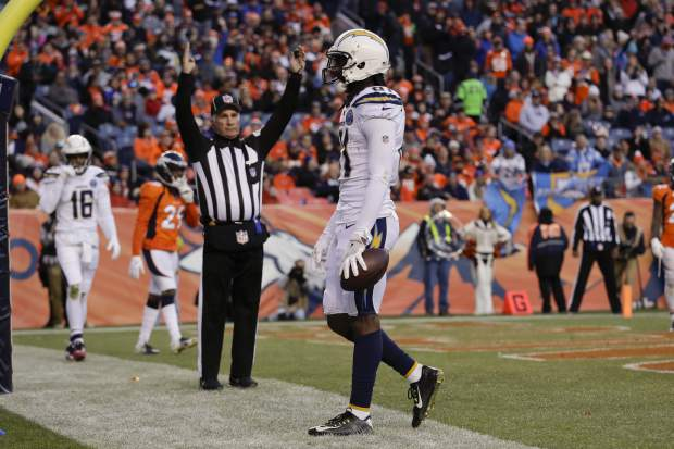 Los Angeles Chargers wide receiver Mike Williams reacts after scoring a touchdown during the second half of an NFL football game against the Denver Broncos, Sunday, Dec. 30, 2018, in Denver. (AP Photo/Jack Dempsey)