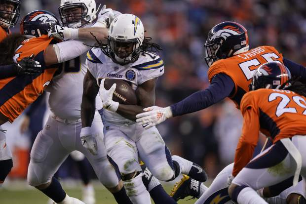 Los Angeles Chargers running back Melvin Gordon rushes during the second half of an NFL football game against the Denver Broncos, Sunday, Dec. 30, 2018, in Denver. (AP Photo/Jack Dempsey)