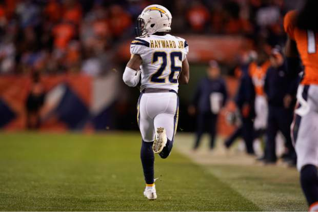 Los Angeles Chargers cornerback Casey Hayward runs an interception back for a touchdown during the second half of an NFL football game against the Denver Broncos, Sunday, Dec. 30, 2018, in Denver. (AP Photo/Jack Dempsey)