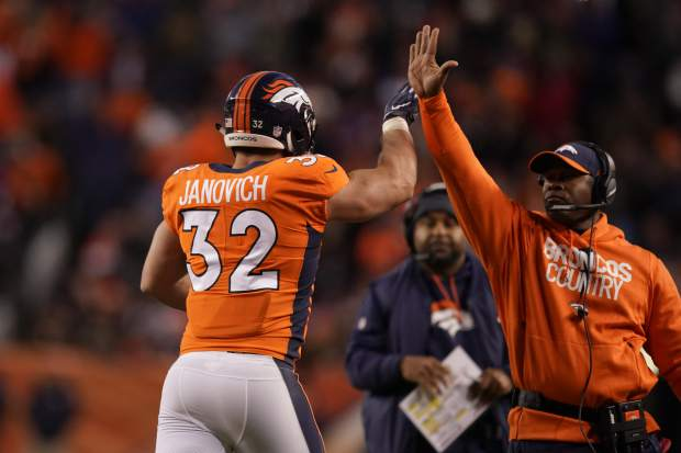 Denver Broncos fullback Andy Janovich (32) celebrates with head coach Vance Joseph after scoring a touchdown during the second half of an NFL football game against the Los Angeles Chargers, Sunday, Dec. 30, 2018, in Denver. (AP Photo/Jack Dempsey)