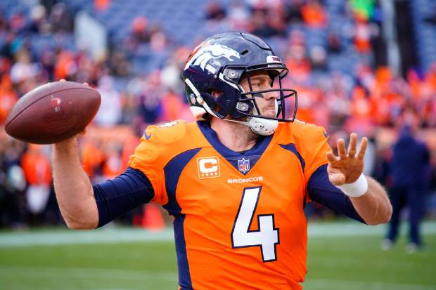 Denver Broncos quarterback Case Keenum warms up before an NFL football game between the Los Angeles Chargers and the Denver Broncos, Sunday, Dec. 30, 2018, in Denver. (AP Photo/Jack Dempsey)