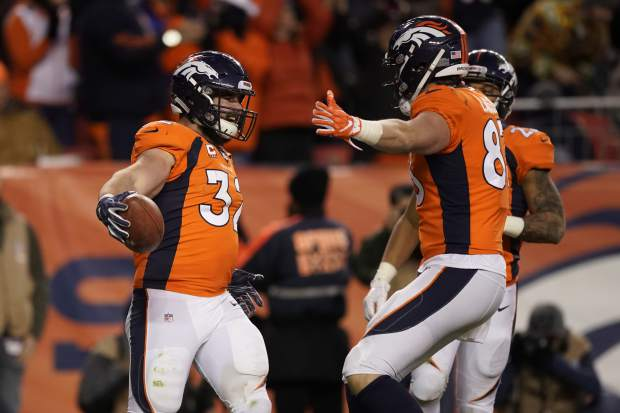 Denver Broncos fullback Andy Janovich, left, reacts after scoring a touchdown during the second half of an NFL football game against the Los Angeles Chargers, Sunday, Dec. 30, 2018, in Denver. (AP Photo/Jack Dempsey)