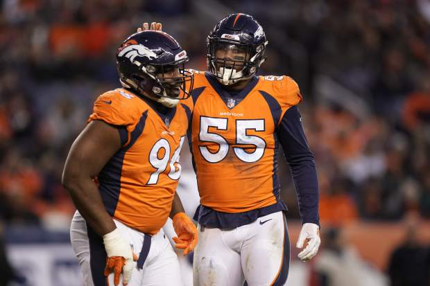 Denver Broncos outside linebacker Bradley Chubb and teammate defensive end Shelby Harris react during the second half of an NFL football game against the Los Angeles Chargers, Sunday, Dec. 30, 2018, in Denver. (AP Photo/Jack Dempsey)