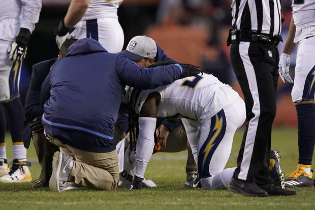 Los Angeles Chargers strong safety Jahleel Addae is helped by trainers after an injury during the second half of an NFL football game against the Denver Broncos, Sunday, Dec. 30, 2018, in Denver. (AP Photo/Jack Dempsey)