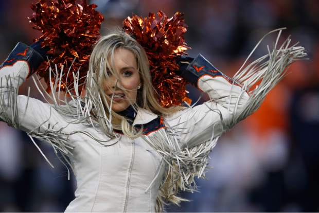 A Denver Broncos cheerleader performs during the second half of an NFL football game against the Los Angeles Chargers, Sunday, Dec. 30, 2018, in Denver. (AP Photo/David Zalubowski)