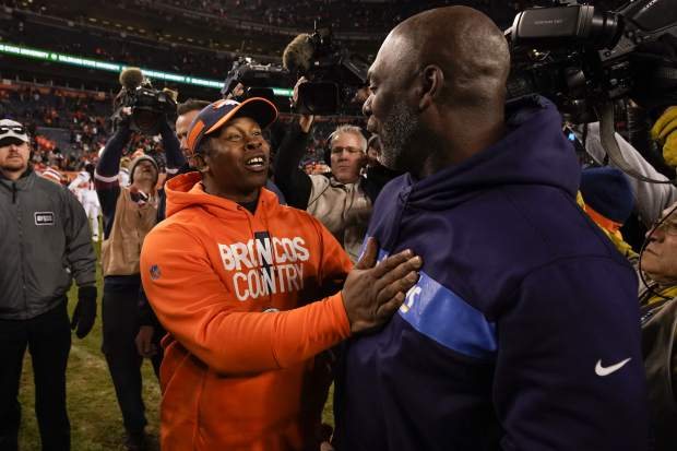 Denver Broncos head coach Vance Joseph, left, greets Los Angeles Chargers head coach Anthony Lynn after an NFL football game, Sunday, Dec. 30, 2018, in Denver. (AP Photo/Jack Dempsey)